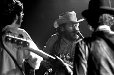 The Band performs at Woodstock -- l-r Robbie Robertson, Levon Helm and Rick Danko. Photo by Elliott Landy.