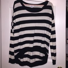 Black and white striped sweater This black & white striped sweater features a high-low design- super cute if worn with boyfriend cut jeans :) Sweaters Crew & Scoop Necks