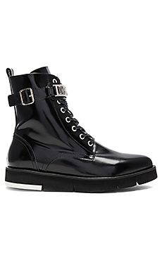 I need these boots in my life! Shop for Love Moschino Ankle Boot in Black at REVOLVE.