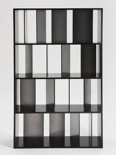 Sundial Bookcase by Kartell. A bookcase with shelving featuring a series of satin-finished or transparent dividers set at slightly different angles like the shadows of a sundial.