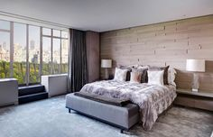 Contemporary Master Bedroom with Embroidered Design Down Filled Throw Pillow, Spectrum Carpeting in Flint, slate floors