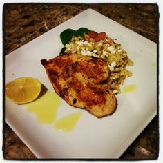 Grilled chicken with warm quinoa salad with almonds, tomatoes, spinach, goat cheese and a lemon and olive oil dressing.