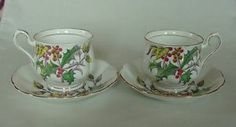 LOVELY PAIR VINTAGE ROYAL ALBERT BONE CHINA CHRISTMAS HOLLY TEA CUP S & SAUCERS