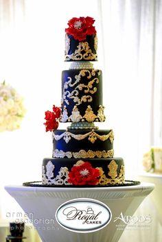 Dramatic! Adorned in Gold- Royal Cakes #weddingcake #royalcakes #gilded #amazingcakes #blackweddingcake #sugarflowers #cakeart #royalweddingcakes  www.RoyalCakesLA.com www.facebook.com/royalcakesla www.instagram.com/royal_cakes Photo Credit: www.ArmenPhoto.com