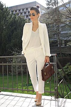 White Pantsuit paired with a plain white tee and a nude classic pumps. Super cool and easy! Add a little brown briefcase handbag and your done!