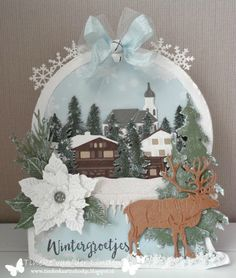 Handmade card by DT member Tineke with among others Craftable Ice Crystals Arch (CR1345), Tiny's Pine Tree Branch (CR1378), Creatables Snowy Icicles (LR0392), Petra's Poinsettia (LR0435), Tiny's Reindeer (LR0442), Austrian Village and Horizon Forrest (LR0444) from Marianne Design