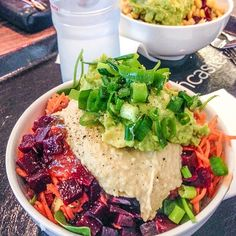 Vegan goodness… scallions, guacamole, hummus?, shredded carrots, cubed beets, greens...