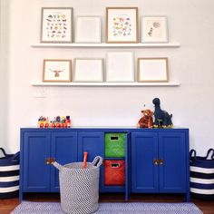 Kids Play Area with Blue Cabinets + Shelves with Artwork + Toy Storage Playroom Organization, Playroom Decor, Kids Decor, Nursery Decor, Playroom Ideas, Organization Ideas, Kids Clothes Storage, Blue Cabinets, Kids Play Area