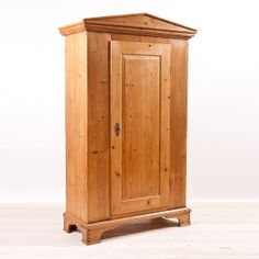 North German Antique Biedermeier Single Door Armoire in pine with Pediment top and Plinth Base, c.1820