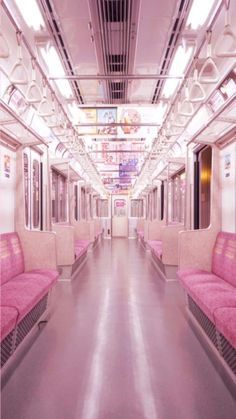 Pink subway seats in an empty subway.