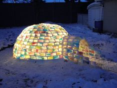 An igloo made of freezed (and watercoloured) ice and snow. They used old milk cans to create those!!!
