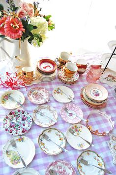 Pretty mismatched vintage dishes make a lovely table setting