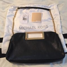 Authentic Berkley Clutch Leather Excellent condition. No Trades. Price is firm. Includes tags and dustbag. Michael Kors Bags Clutches & Wristlets