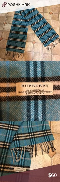 Authentic Burberry teal signature pattern scarf Authentic Burberry signature print scarf, light bluish/ teal color with black/ white/ purple. Tassel ends, 100% lambs wool. Mint condition- no rips/stains/holes etc. Burberry Accessories Scarves & Wraps