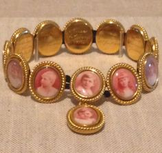 Queen Victoria's bracelet, composed of gold, porcelain, elastic and transfer printed photograph. This bracelet was worn constantly worn by Queen Victoria. This was one of a group of jewels placed in the 'Albert Room' at Windsor Castle after the Queen's death in 1901. This was the room in which Prince Albert had died in 1861 and the Queen left instructions for a specific list of personal jewellery to be placed there and not passed on in the family. #Victorian