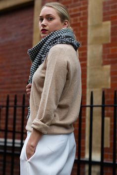 camel sweater with houndstooth scarf over white pants