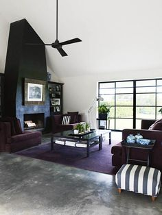 We love a white fireplace as much as the next gal, but this all-black take makes a wonderfully bold statement.