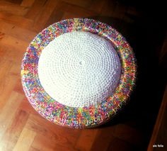 motorcycle and car wheels turned into pouf with my art.  cushion of recycled plastic bags