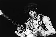 Image result for jimi hendrix guitar on fire