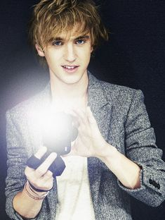 Tom Felton. (I love the flash on the camera he is holding, very cool!)