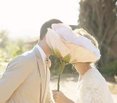 Share Tweet Pin Mail When I got married about a year and a half ago I dreamed up a reception overflowing with oversized flowers. ...