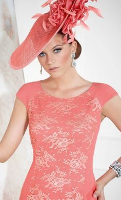 A sophisticated formal day wear design by Veni Infantino, comes with a matching jacket.