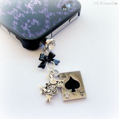 Get lost in Wonderland with a cute phone charm. Find it at my #etsy shop. #accessories #phonecharm #aliceinwonderland