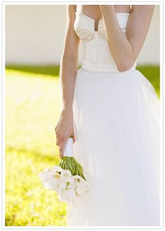 Beautiful #weddinggown...it's modern and super pretty!  From http://100layercake.com/blog/2012/07/18/south-african-wedding-kris-and-heike/#comment-284457  Dress by http://kluk.co.za/Default.html  Flowers by http://diegieter.co.za/  Photo Credit: http://welovepictures.blogspot.com/