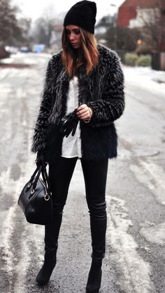 Go high fashion style with a large fur jacket and a structured black leather purse. Very sleek, very now, very cool. www.justblynk.com