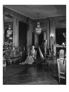 640 Fifth Ave. | Grace Wilson [Mrs. Cornelius III] Vanderbilt photographed by Cecil Beaton (Nov 1941) for Vogue, dressed in full evening regalia seated in a Luis XVI chair with a harp to her left in the music room of the Vanderbilt mansion, 640 Fifth Avenue.