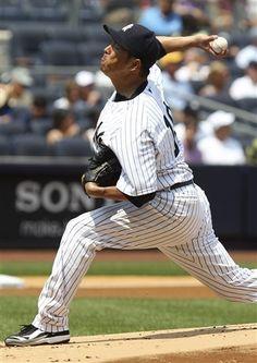 GAME 91: Wednesday, July 18, 2012 - New York Yankees starting pitcher Hiroki Kuroda, of Japan, pitches during the first inning of a baseball game against the Toronto Blue Jays at Yankee Stadium in New York. (AP Photo/Seth Wenig).