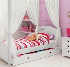 The Mia White Four Poster Single Bed from Argos looks divine. Part of the Mia collection, this charming white four poster bed combines form and function with the cut-out heart motifs which act as both decoration and as handles on the handy pull-out drawer.