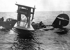 """Downed flyer being rescued by the crew of a Walrus. Circa 1942. """