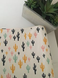 Lets put the finishing touches on your nursery with this Arizona Cactus changing pad cover! This pattern design fits a standard contoured changing pad mattress. All seams are serged for a professional and durable finish, and encased in elastic all the way around the cover for a snug fit.  We have taken special care of this fabric by pre-washing and pre-drying to prevent fading and shrinkage. We recommend machine washing in cold water, with a low heat dryer setting. Iron on the opposite side…