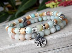 About the Bracelet This mellow nature bracelet is made with love calming amazonite and coco wood, giving a feeling of peaceful energy. Bracelet Details: This beautiful bracelet is made with: ♥ 6mm Matte Fl