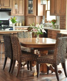 great kitchen remodel... i like the appliance garage in the corner and how the seagrass chairs update the old oak table