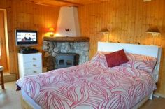 Downstairs double bedroom Chalet Papillon garden apartment in the Portes du Soleil region near Morzine. Ideal for pares ski relaxing