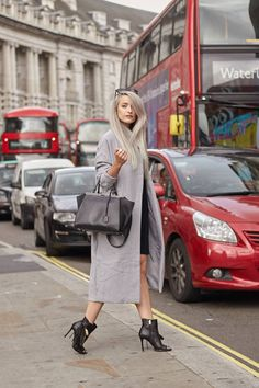 What I wore to London Fashion Week S/S16 Day 1! cA long grey oversized coat, Coach black heeled booties, a Fendi 3jours Tote, and a whistles sack dress!