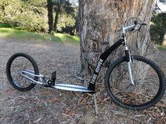 Spring loaded kick bike