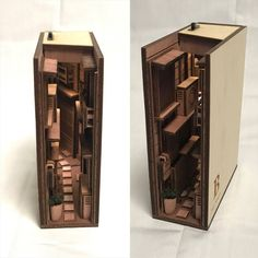 Based in Tokyo, Japanese designer monde has created a new category of art and design – bookshelf dioramas. His wood inserts transform ordinary bookshelves into something magical and bring the… Vitrine Miniature, Miniature Houses, Tokyo, Wooden Bookends, Floating Bookshelves, Bookshelf Ideas, Bookcase, Alleyway, Japanese Design