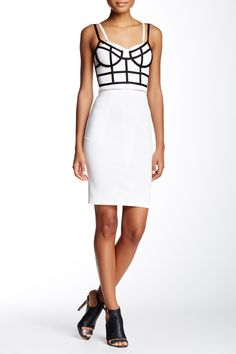 Geometric shadow add a playful touch to this white body-con dress.
