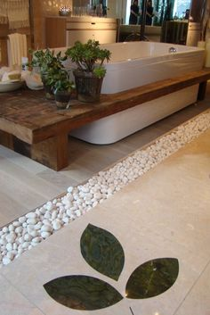 wood, white tub, the stones between both floors and the plants in a bathroom <3