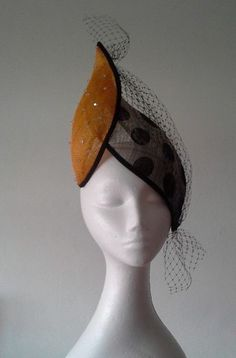 Headpiece - small orange sinamay and large polkadot sinamay twist.  Swarovski crystals and black eye veiling.  Hat elastic.  One size fits most. http://johannaguerinmilliner.bigcartel.com/product/double-twist
