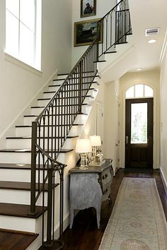 1215 Wynden Commons Ln - An open foyer greets you upon entry. Wrought iron balusters and walnut floors continue up the stairs.