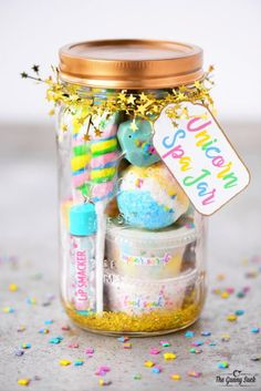 Mason Jar Crafts You Can Make and Gift! This DIY Unicorn Spa Jar via The Gunny Sack makes a delightful gift for unicorn lovers! Using a combination of purchased and handmade components, this DIY includes recipes for unicorn bath bombs, a unicorn foot soak and unicorn soap and sugar scrubs! #unicorns #masonjarcrafts #masonjargifts #diy #bathbombs