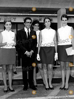 Alexander Onassis, with Olympic Airlines stewardesses.