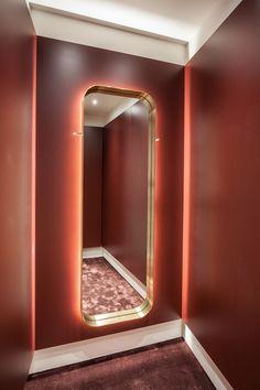 Baciocchi Associati combines a vivid colour palette with signature brass elements for luxury retail - News - Frameweb