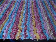 This looks like a great way to make a rag rug/quilt.