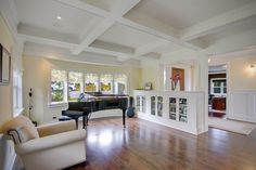 Kirkland Tanditional traditional living room; love the half wall cabinets...and I'll take the grand piano too!