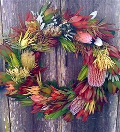 A beautiful Christmas wreath made with Australian native flowers. It's always nice to add a touch of Australian charm to Christmas and these flowers and foliage are perfect as they dry well and last ages! Pic by Dig Gardens Aussie Christmas, Australian Christmas, Summer Christmas, Tropical Christmas, Christmas Flowers, All Things Christmas, Christmas Crafts, Christmas Decorations Australian, Christmas Ideas
